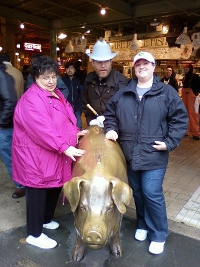 My family petting Rachel at Pike's Place